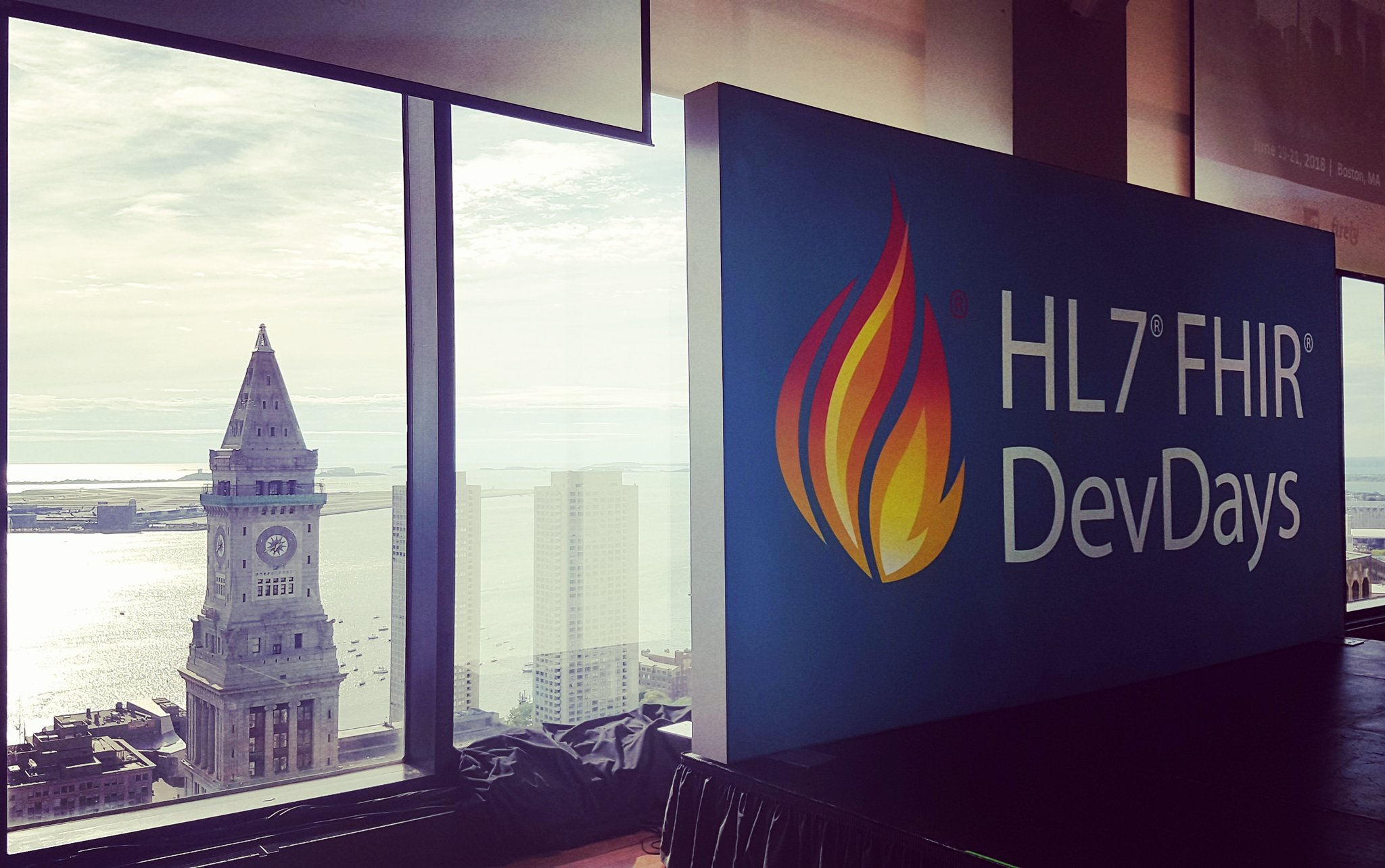 FHIR DevDays sign with Boston backdrop-1